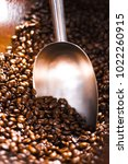 measuring spoon and coffe beans | Shutterstock . vector #1022260915