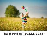 happy baby boy standing in... | Shutterstock . vector #1022271055