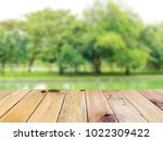 empty top wooden table and... | Shutterstock . vector #1022309422