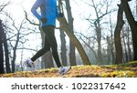 young sports man running in the ... | Shutterstock . vector #1022317642
