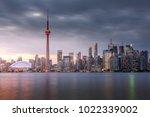 sunset over modern buildings in ... | Shutterstock . vector #1022339002