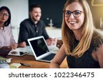 smiling young businesswoman... | Shutterstock . vector #1022346475