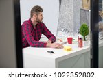 concentrated on work.... | Shutterstock . vector #1022352802