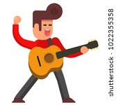 excited young man with acoustic ...   Shutterstock .eps vector #1022355358