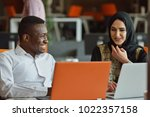 group young coworkers making...   Shutterstock . vector #1022357158