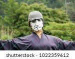 scarecrow in the field looking... | Shutterstock . vector #1022359612