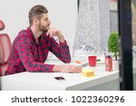 concentrated on work.... | Shutterstock . vector #1022360296