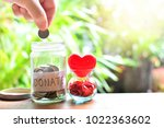 putting coins money in donate...   Shutterstock . vector #1022363602
