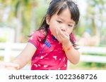little asian girl vomiting in... | Shutterstock . vector #1022368726
