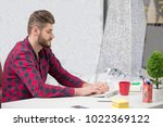 concentrated on work.... | Shutterstock . vector #1022369122