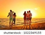 people celebration beach party...   Shutterstock . vector #1022369155