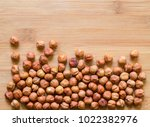 nuts on wooden background | Shutterstock . vector #1022382976