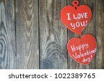 red hearts lie on wooden brown... | Shutterstock . vector #1022389765