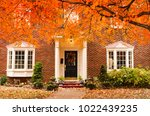 red brick house entrance with... | Shutterstock . vector #1022439235