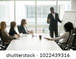 african businessman presenting... | Shutterstock . vector #1022439316