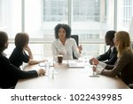 black female boss leading... | Shutterstock . vector #1022439985