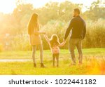 family playing in autumn park... | Shutterstock . vector #1022441182