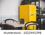 bright retro yellow fridge in... | Shutterstock . vector #1022441398