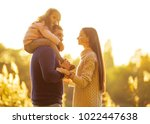 family playing in autumn park... | Shutterstock . vector #1022447638