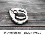 handcuffs  wedding rings on a...   Shutterstock . vector #1022449522