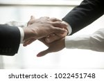 african and caucasian partners... | Shutterstock . vector #1022451748