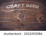 beer menu on an old wooden plank | Shutterstock . vector #1022453086