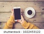 woman using a white smartphone... | Shutterstock . vector #1022453122