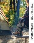 Woman Sitting On Picnic Bench...