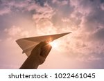 Hand Throwing Paper Airplane....