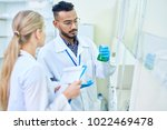 team of young scientists... | Shutterstock . vector #1022469478