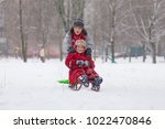 two happy boys riding at the... | Shutterstock . vector #1022470846