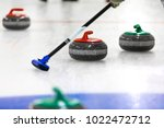 curling game   stones and broom ... | Shutterstock . vector #1022472712