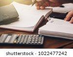 businessman hand holds pen... | Shutterstock . vector #1022477242