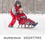 two happy boys riding at the... | Shutterstock . vector #1022477452
