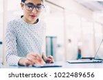 female receptionist checking... | Shutterstock . vector #1022489656