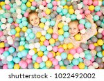 two adorable friendly girls... | Shutterstock . vector #1022492002