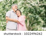 happy smile senior asian couple ... | Shutterstock . vector #1022496262