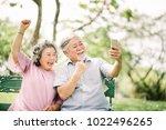 happy senior asian couple... | Shutterstock . vector #1022496265