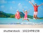 father and kids enjoying beach... | Shutterstock . vector #1022498158