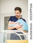 father with newborn child.... | Shutterstock . vector #1022499166