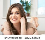 portrait of woman lying on sofa.... | Shutterstock . vector #102252535