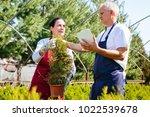 senior couple of gardeners or... | Shutterstock . vector #1022539678