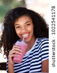 portrait of smiling young woman ... | Shutterstock . vector #1022541178