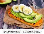 sweet potato toast with avocado ... | Shutterstock . vector #1022543482