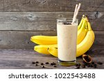 coffee  banana smoothie in a... | Shutterstock . vector #1022543488