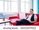working at home. young man... | Shutterstock . vector #1022547022