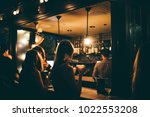 moody drinks on rooftop bar | Shutterstock . vector #1022553208