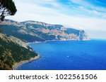 rocky coast with mountains and... | Shutterstock . vector #1022561506