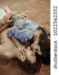 happy young couple having fun... | Shutterstock . vector #1022562352