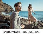 elegant man man posing with his ... | Shutterstock . vector #1022563528